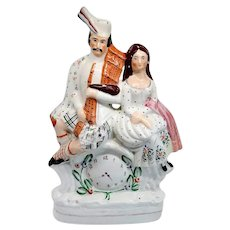 Large English Staffordshire Pottery Flatback Figural Group of a Scottish Couple and Clock