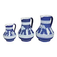 Set of Three English Wedgwood Dark Blue Jasperware Graduated Pitchers