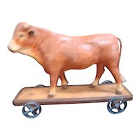 Early Bull on Wheels -  Pull Toy