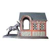 J. E. Stevens Mechanical Bank- Mule Entering the Barn