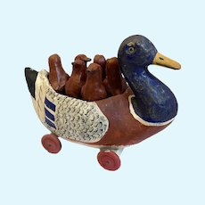 A papier-maché skittles set in a duck, French, circa 1890
