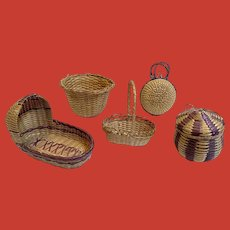 A set of five very early straw dollhouse accessories