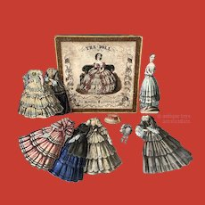 """A boxed paper doll """"THE DOLL"""", circa 1850"""