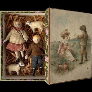"A pair of 2,8"" all-bisque dollhouse dolls, German, circa 1890"