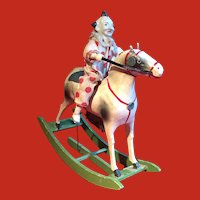 A clown on a rocking horse automaton