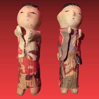 A pair of miniature Chinese dolls