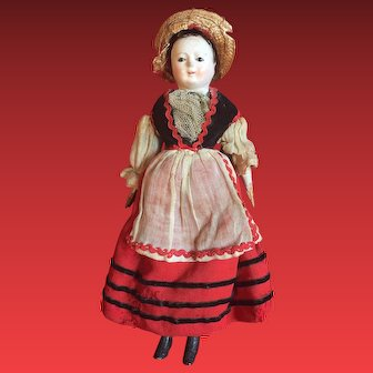 A small and sweet paper mache Pauline type doll with glass eyes