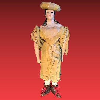 A beautiful early papier mache doll originally dressed