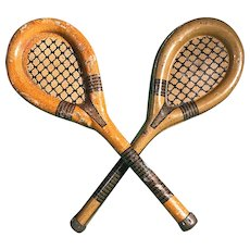 A pair of  penny toy tennis rackets/candy containers