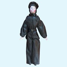 A small papier mache doll with all-wooden jointed body, German circa 1850