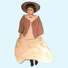 An early Dutch wooden doll