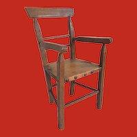 An 18th Century elm wood dolls chair