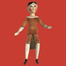 "An unusual 23,6"" tall peg wooden Grodnertal doll, circa 1840"