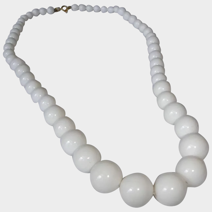 Classic Beauty Comes In This 4 Strand Beaded Necklace With Clasp.