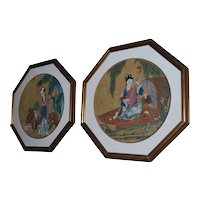 A pair of circular Chinese painted panels