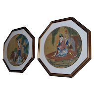 A pair of circular Chinese painted panels