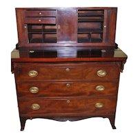 A Federal New England mahogany tambour secretary chest