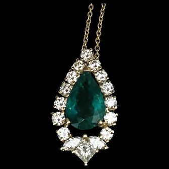 an Emerald Vintage Pendant with diamonds