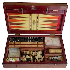 Compendium. Games compendium. Box of games. Chess. Checkers. Chutes and ladders. Dominoes. Whist. Cribbage. Etc.