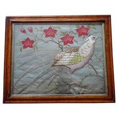 Needlework sampler of a bird. Silk-work panel. Embroidery.
