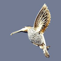 14 Karat Yellow, White, and diamond Hummingbird Pin