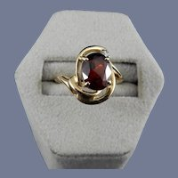 14 Karat Oval Garnet and Diamond Ring