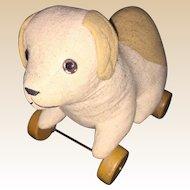 Antique Cloth Straw Stuffed Glass Eyed  Doggy On Wheels