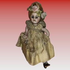 """Antique All Bisque 4"""" Glass Eyed Pocket Doll"""