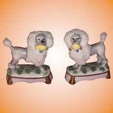 Antique German 19th Century Staffordshire Type Miniature Porcelain Poodles Holding Baskets