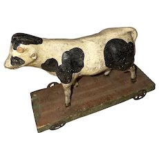 Antique German Miniature Paper Mache Cow Platform Floor Toy