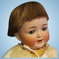 """Vintage wig in a """"bob"""" style  for baby Doll  or toddler German or French with 12"""" in head circumference"""