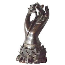 Buddha Hand , bronze statue, holding a lotus .