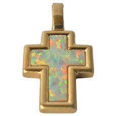 Gold ( 18k ) vintage  cross with opal inlay.