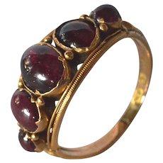 An  antique 18k Gold Five-stone Garnet Ring, 1873.