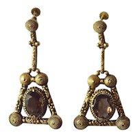 Silver gilt earrings / smoky quartz oval stones.