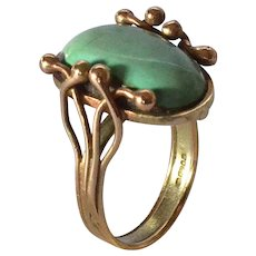 A gold ring / oval turquoise cabochon.