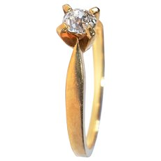 Vintage gold Swiss solitaire diamond ring.
