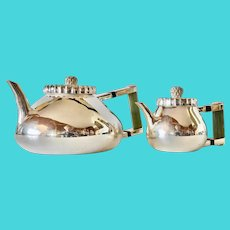Silver-plated tea pot and a matching jug, Ravissant of India, 1995.