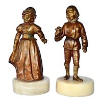 Metal figurines on marble bases, boy and girl, 1950c.