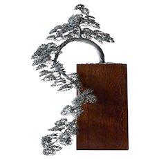 Vintage bonsai (steel wire) tree on wooden base.