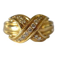 "A vintage, 1990, Tiffany & Co. ""Signature Collection"" 18k yellow gold ring."