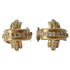 A Tiffany & Co. 18k yellow gold and diamond earrings, 20th century.