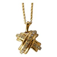 A Tiffany & Co. 18k yellow gold and diamond pendant with chain., 20th century.