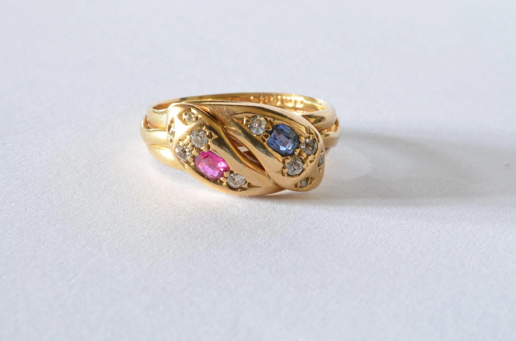 A Diamond Sapphire And Ruby Set Double Head Snake Ring