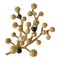 Black and white Grosse pearl ( cultured ) set 14 ct gold floral spray brooch, 1966.