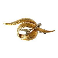 A Carl Bucherer, 18 ct ( 750 ) gold scroll brooch, circa 1980.