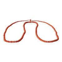 A graduated pink coral bead necklace, 1910c.