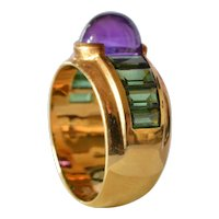 A gold ( 18ct. ) ring with amethyst and tourmeline, mid 20th century.