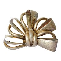 Early vintage silver ( 830 ) Scandinavian bow brooch.