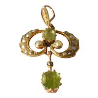 An Edwardian , 1910, gold ( 15ct ) peridot set pendant.